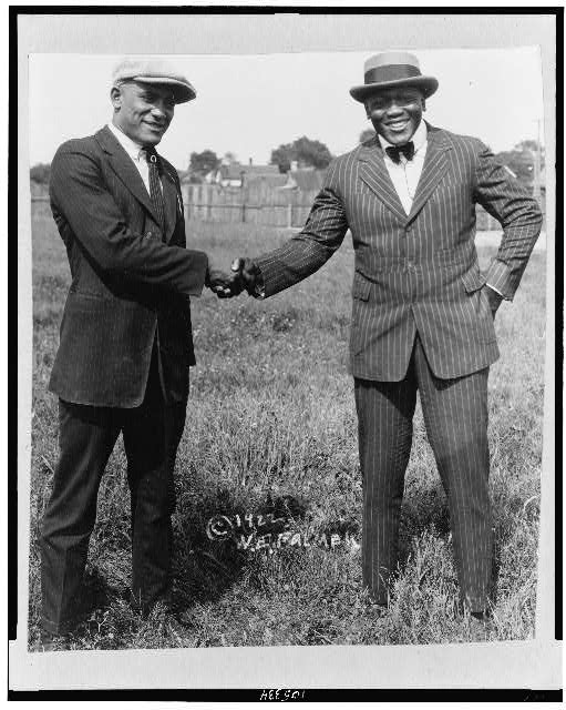 [Tut Jackson (left) and Jack Johnson shaking hands]