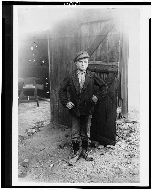 #95. A Glass Works Boy Waiting for the Night Shift, Indiana. Aug., 1908.  Location: Indiana.