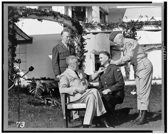[Casablanca conference at Casablanca, Morocco, President Roosevelt with Major General George S. Patton, Jr., affixing the Congressional Medal of Honor upon Brig. General William H. Wilbur in the presence of General George C. Marshall]