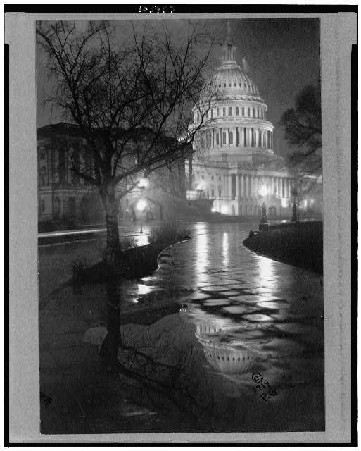 [View of the U.S. Capitol, at night, in rain]