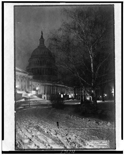 [View of the U.S. Capitol, at night, with snow]