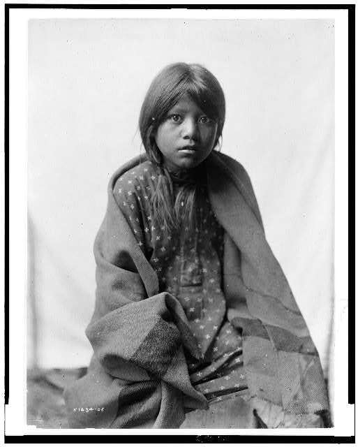 [A Taos girl, three-quarter length portrait, seated, facing front]