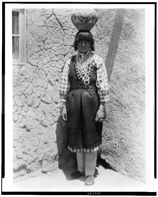 [Shuati--Sia. Full-length portrait of a woman standing, facing front, with pot on head]