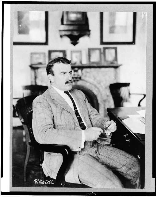 [Lee McClung, three-quarter length portrait, seated at desk, facing right]