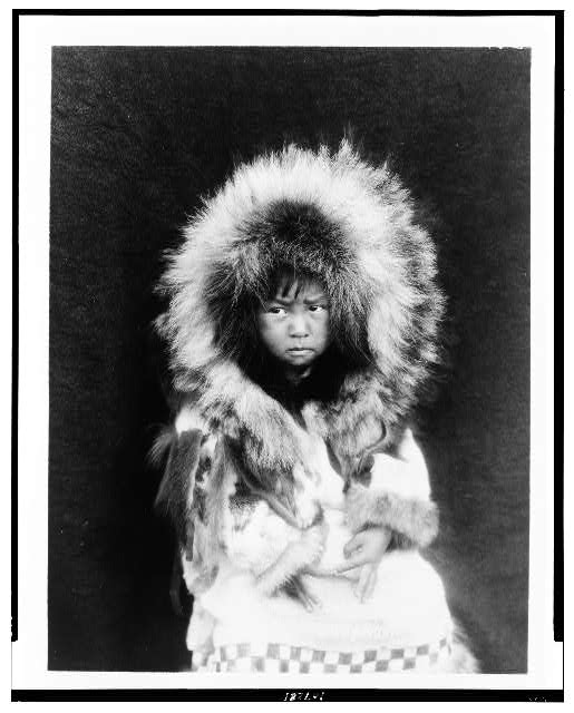 [Noatak child, three-quarter length portrait, seated, facing front]