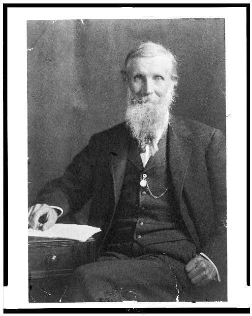 [John Muir, three-quarter length portrait, seated, facing front]