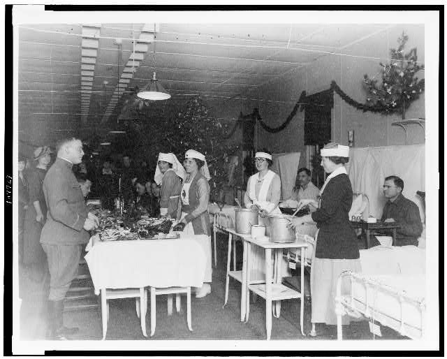 [Red Cross nurses serving food to soldiers in hospital, during Christmas season]
