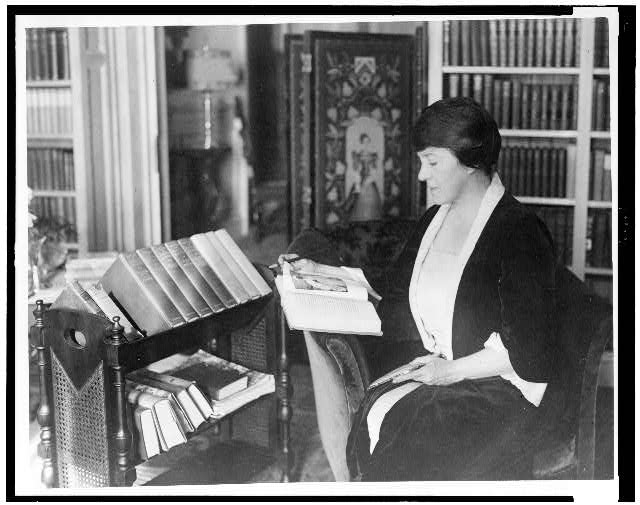 [Mary Roberts Rinehart, three-quarter length, seated, facing left, reading book]
