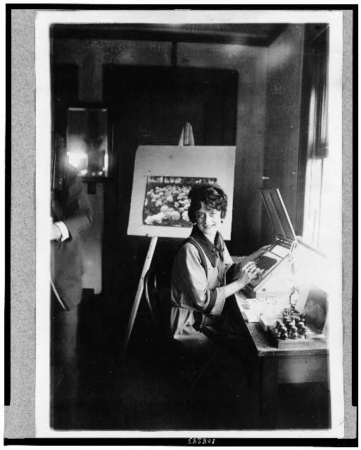 Mrs. Elsie Sellers, colorist in the U.S. Dept. of Agrl., makes posters and lantern slides for fairs and conventions throughout the country