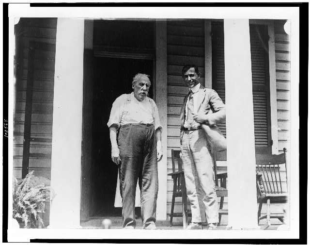 [L.D. Anderson, of Anacostia, 95 years old, oldest member of Metropolitan Police, full-length, standing on porch, with another man, facing slightly right]