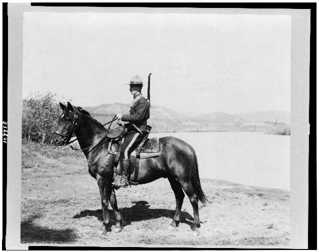 [Royal Canadian northwest mounted policemen on horseback, Dawson, Yukon Territory, Canada]