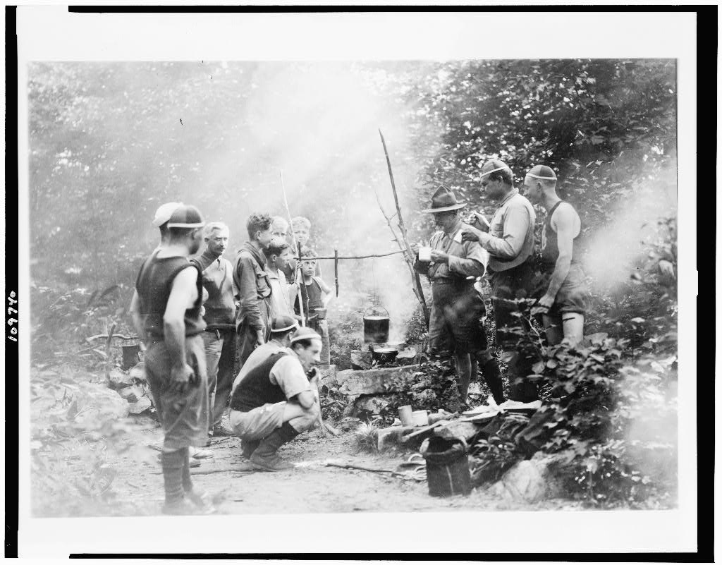 Boy Scouts cooking over open fire at Camp Ranachqua. 1919.