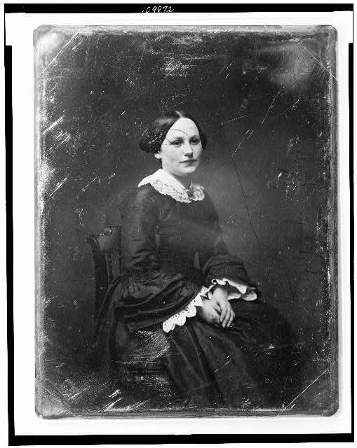 [Unidentified woman, about 20 years of age, three-quarter length portrait, three-quarters to the right, seated, hands in lap]