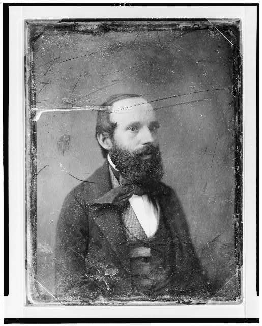 [Unidentified man, about 35 years of age, head-and-shoulders portrait, three-quarters to right, with full beard]