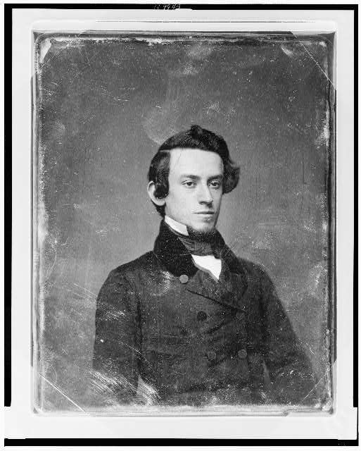 [Unidentified man, about 20 years of age, head-and-shoulders portrait, three-quarters to right]