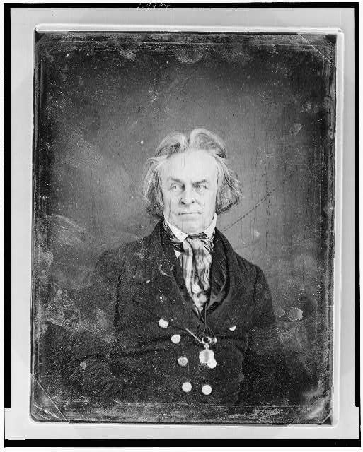 [Unidentified man, about 60 years of age, half-length portrait, facing front, eyes to left, wearing plaid cravat and monocle suspended on cord around neck]