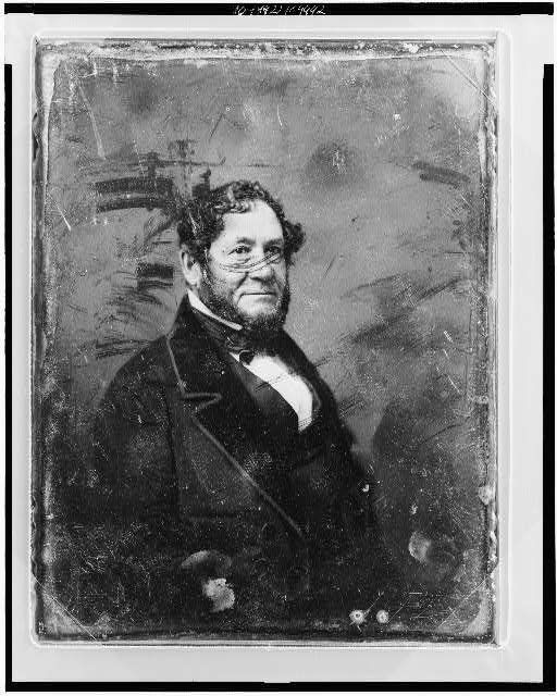 [Unidentified man, half-length portrait, facing three-quarters to right, with beard]