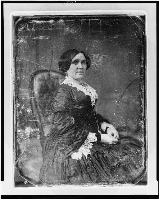 [Unidentified woman, about 40 years of age, three-quarter length portrait, body to right, facing front, seated in upholstered chair, hands in lap]