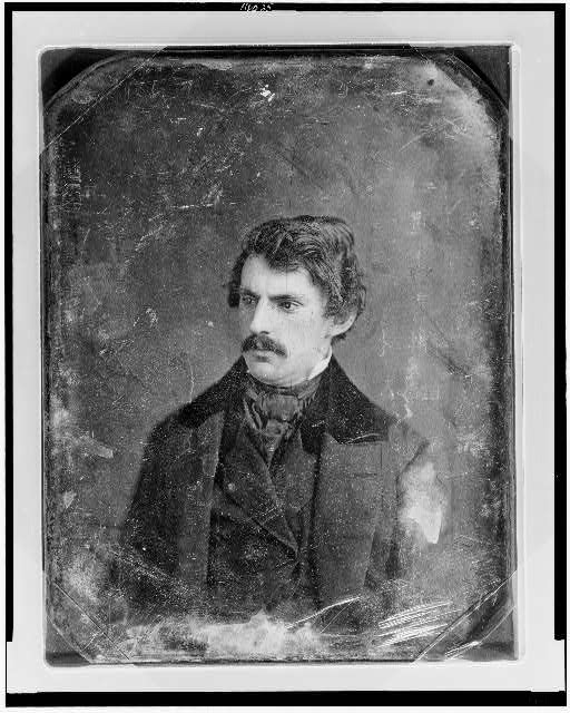 [Unidentified man, about 30 years of age, head-and-shoulders portrait, three-quarters to the left, with mustache]