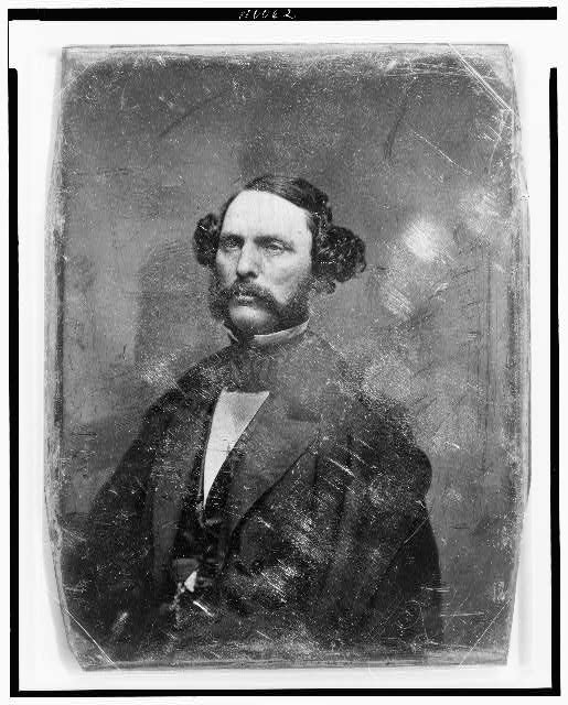 [Unidentified man, about 40 years of age, half-length portrait, three-quarters to the left, with mustache and side whiskers]