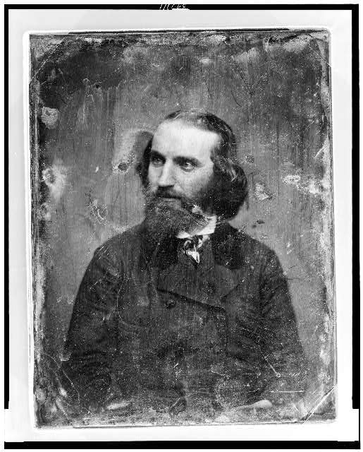 [Caleb Lyon, head-and shoulders portrait, three-quarters to the left, with beard]