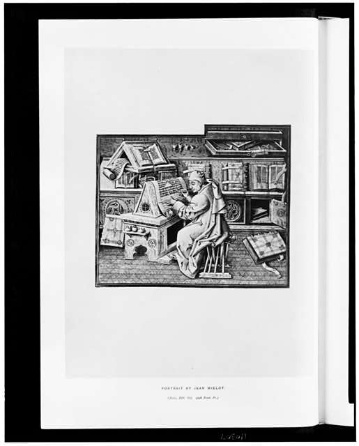 [Medieval scribe Jean Milot, sitting at a desk, making a copy of another book]