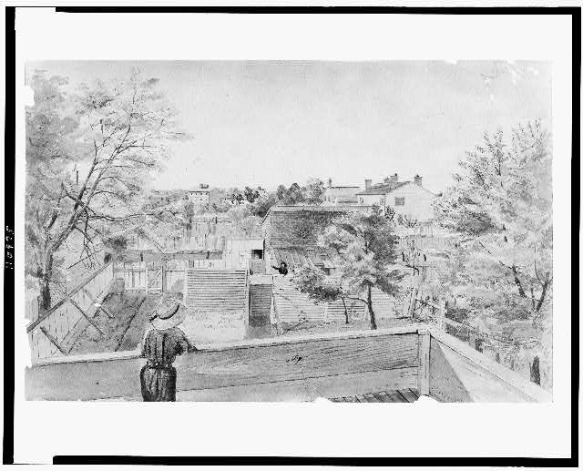 [View from the 2nd story of the residence of Mrs. Comre. John Rodgers, Franklin Row, K Street at 12 & 13 Sts, Washington, D.C., overlooking the backyard and adjacent neighborhood, and showing children standing on balconies]