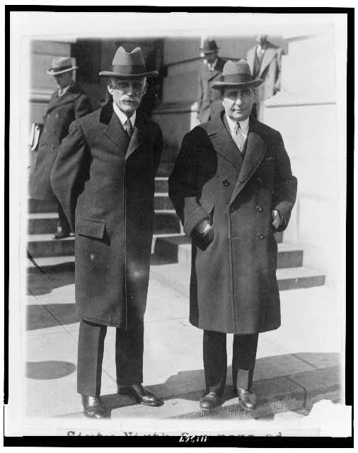 [Andrew W. Mellon and Ogden Mills, full-length portrait, facing front, standing outside the Capitol, after closing session of the Sixty-Ninth Congress]