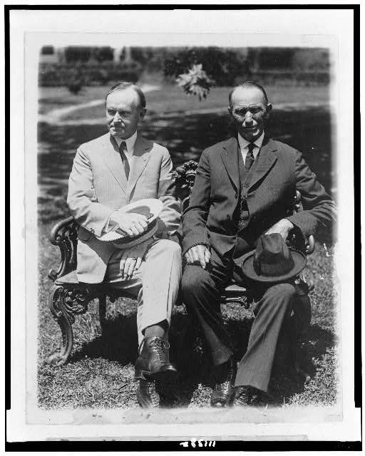 [President Coolidge and his father, full-length portraits, seated on lawn chair]