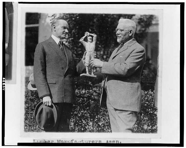 U.S.J. Dunbar presents a statue of Walter Johnson [to President Coolidge]