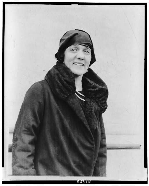 [Mrs. Dorothy Harrison Eustis, half-length portrait, standing, on ship(?), facing slightly right]
