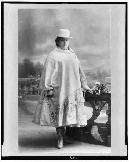 [Chola woman, full-length portrait, standing, facing right, La Paz, Bolivia]