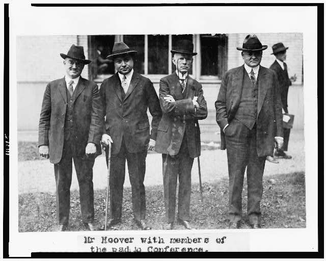 [Herbert Hoover and three members of the Radio Conference, posed standing, full-length]