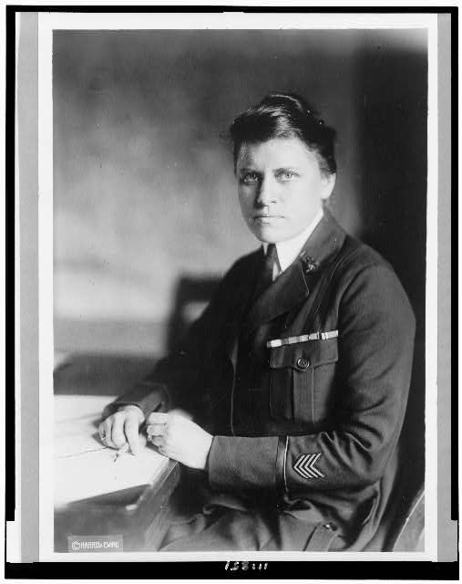 [Julia Catherine Stimson, half-length portrait, in uniform, seated, facing left]