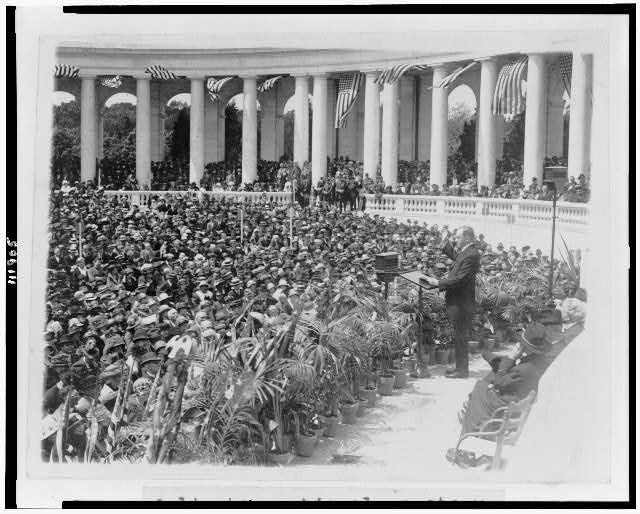 [President Coolidge addressing crowd at Arlington National Cemetery]