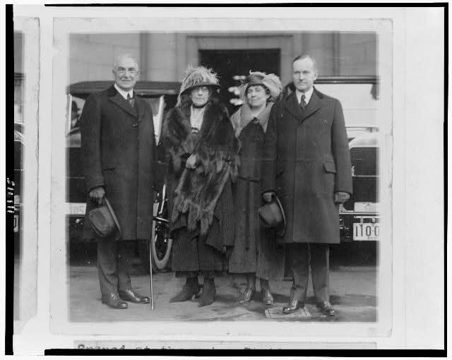 [President and Mrs. Harding and Vice President and Mrs. Coolidge standing at Union Station, on their arrival for the inauguration]