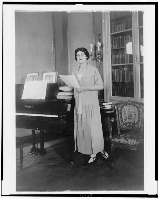 [Alma Gluck, full-length portrait, standing by piano, facing slightly left]