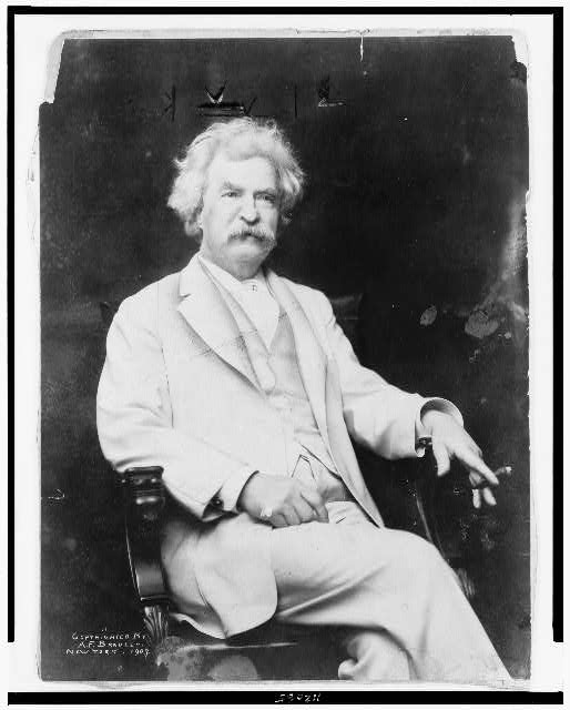 [Mark Twain, three-quarter length portrait, seated, facing slightly right, with cigar in hand]