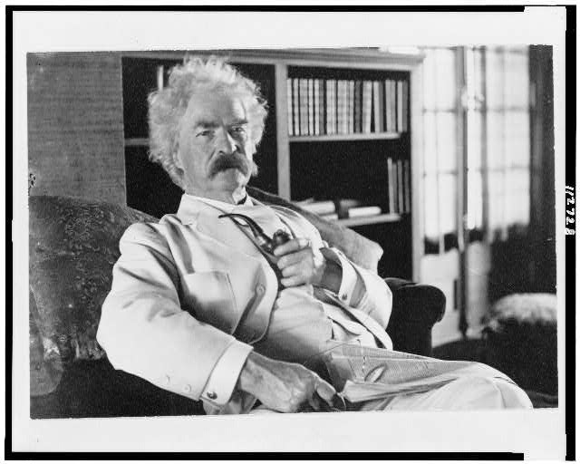 [Samuel Langhorne Clemens, three-quarter length portrait, seated, facing slightly right, holding pipe]
