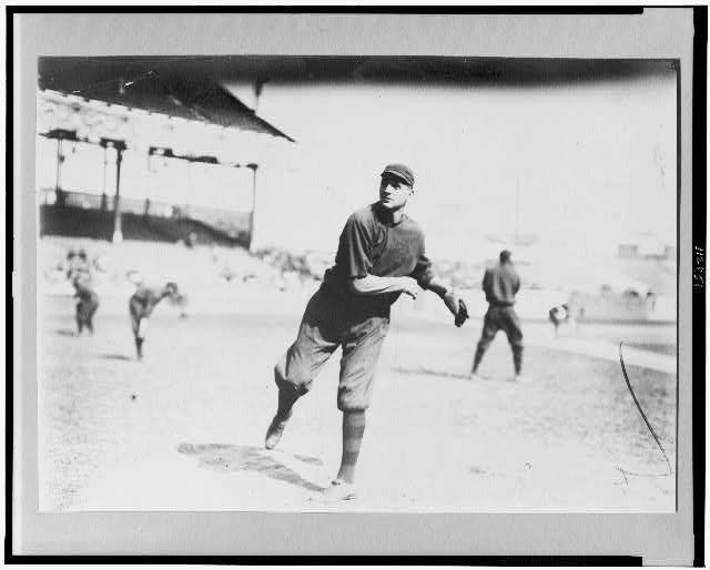 [William Lawrence James, Boston NL baseball player, throwing ball on baseball field]