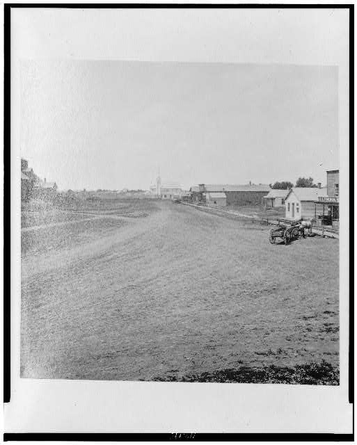 [Street with buildings and horse and wagon]