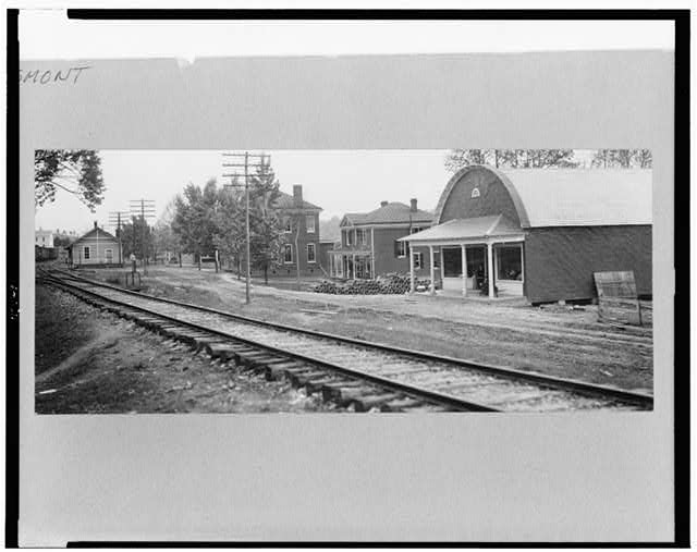 [Town of Esmont, Virginia, with railroad tracks in foreground]
