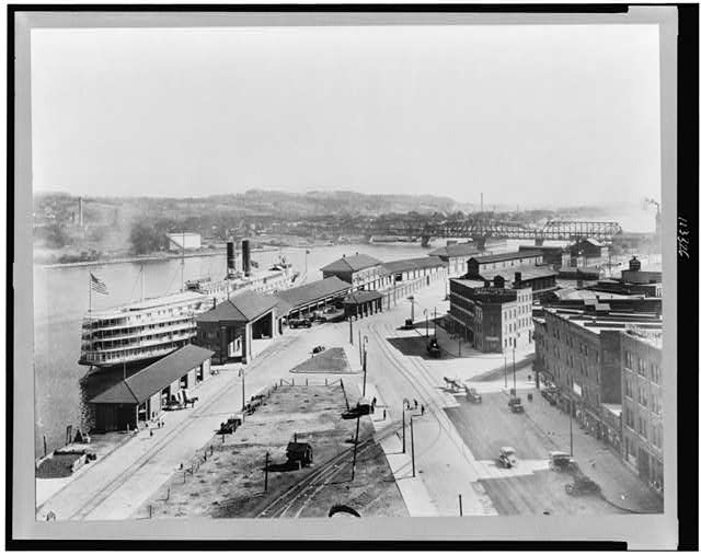 [Bird&#39;s-eye view of wharf area of Albany, New York, showing night boat landing, and bridge in background]