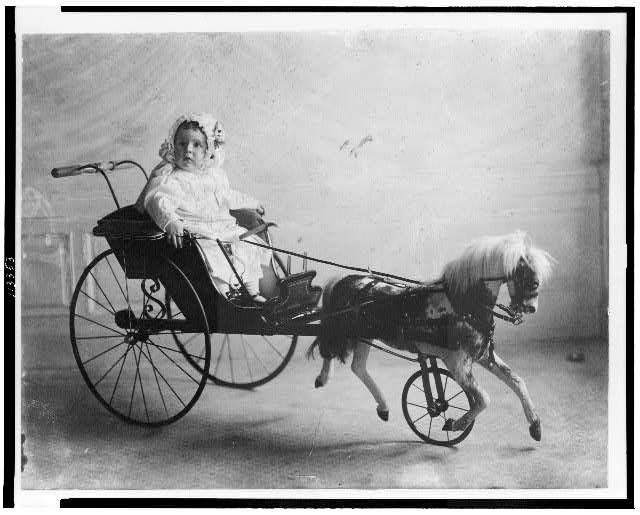 [Vinson Walsh McLean, baby son of Evalyn McLean in carriage with toy horse in front] ]