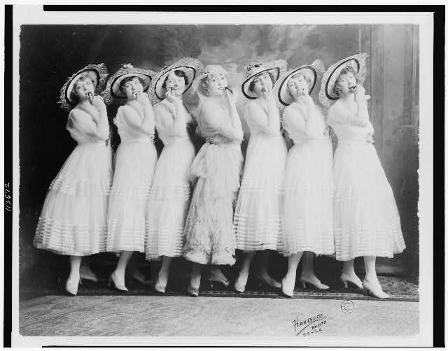 "[Seven ""Canary Cottage"" young women of the burlesque theater, posed, full-length, standing]"