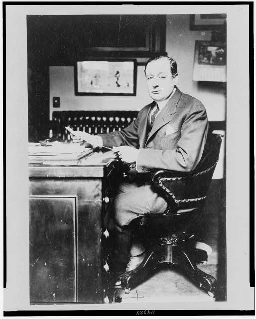 [James E. Gaffney, full-length portrait, facing front, seated at desk]