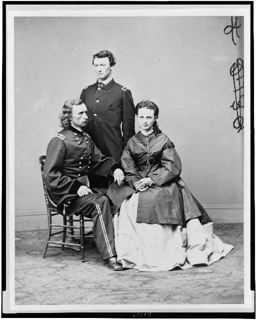 "[George Armstrong Custer, in uniform, seated with his wife, Elizabeth ""Libbie"" Bacon Custer, and his brother, Thomas W. Custer, standing]"