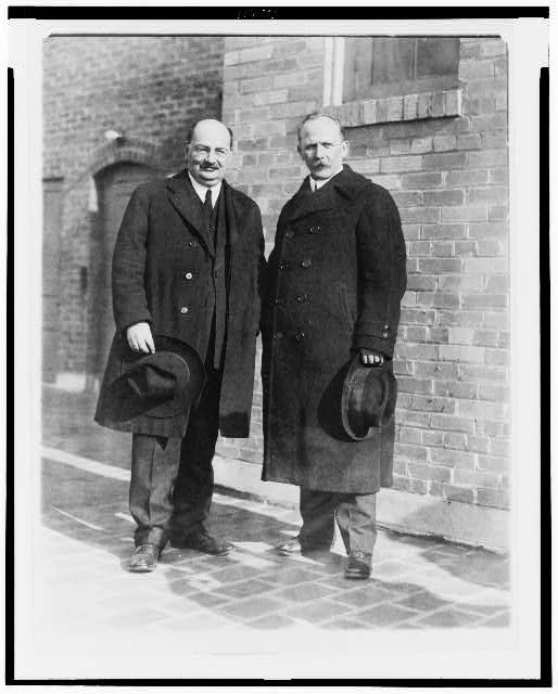 [Lyudvig Martens (left) and his secretary, Mr. S. Nuorteva(right), posed standing, full-length, facing front]