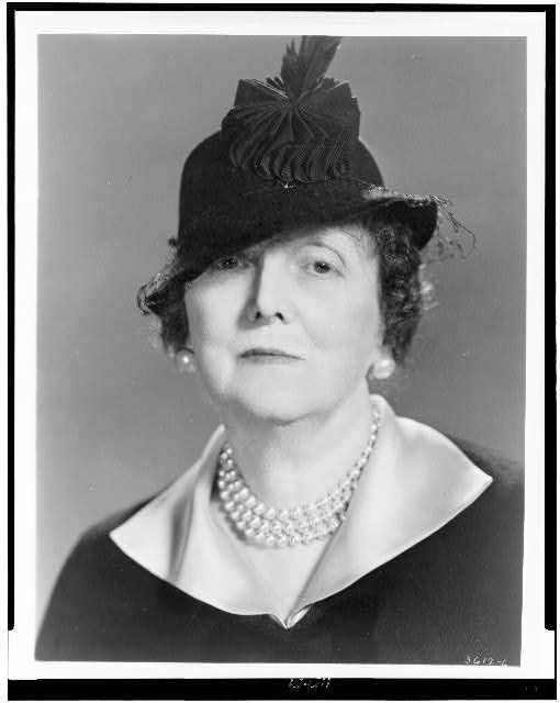 [Emily Post, head-and-shoulders portrait, facing front, wearing hat]