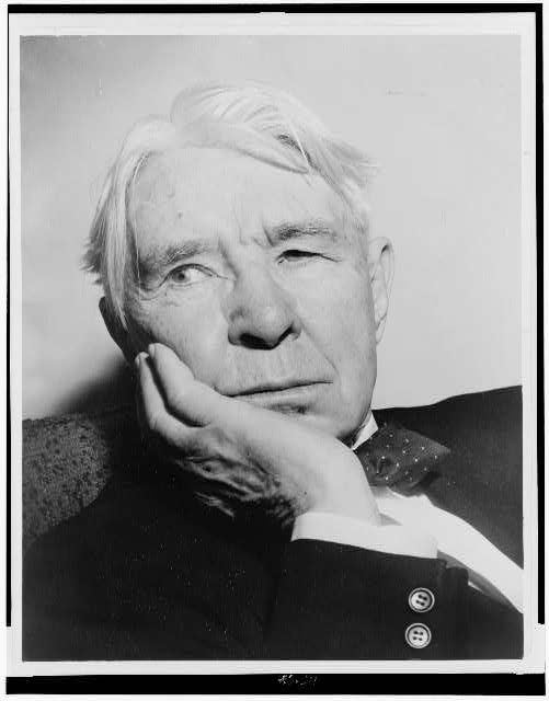 [Carl Sandburg, head-and-shoulders portrait, facing left]